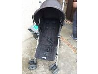 Black McLaren pushchair with rain hood also. Very good condition