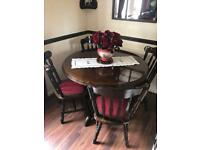 Dark wood round dining table
