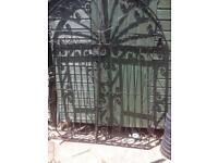 Pair of ornate arched wrought iron gates