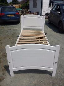 Childs single white wooden bed