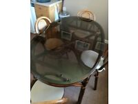 Glass top bamboo table and 4 chairs