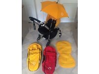 Bugaboo Bee Plus with Parasol, footmuff cocoon x2, forward & rear facing, yellow & red accessories