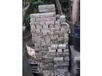 Large quantity reclaimed clean Bradstone / Marshalls type walling bricks.Various sizes. Rough cast.