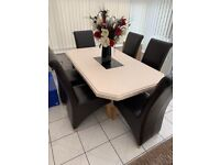 Italian Stone Dining Table with Leather chairs