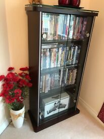 Modern mahogany/glass display cabinet 60 x 26 x 115cm high, suitable for ornaments or DVD's