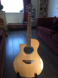 For sale, Left handed APX 700 semi acoustic guitar.
