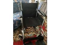 Wheelchair, gel seat and fleece lined apron.