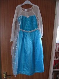 Elsa's dress size something like 6 to 7 or 7 to 8 years £5 pounds
