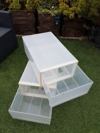 Plastic under bed storage boxes.