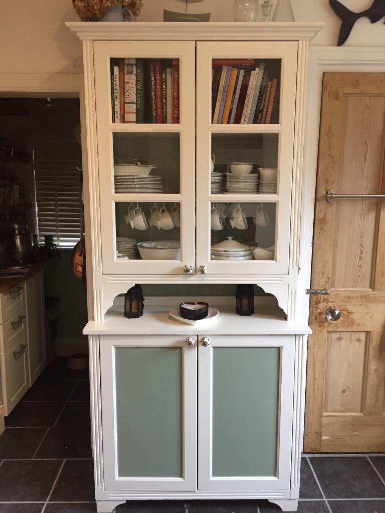 small kitchen dresser with glass doors