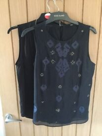 Two sleeveless shift tops, size 12, blue and black.