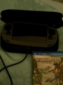 PS Vita, case, charger & Uncharted game