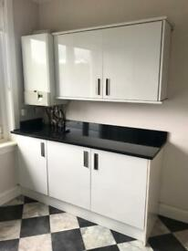 White Gloss and Black Granite Kitchen with Appliances
