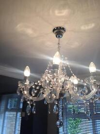 Chandelier clear five arm ceiling light. Another identical chandelier listed