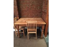 Pine dining table with two chairs