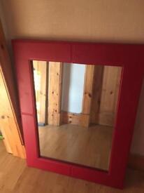 Rectangular red framed mirror