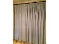 A pair of gingham blue and while pencil pleat curtains