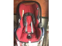 Excellent condition maxi cosy baby car seat in a deep red