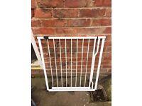 White metal baby gate