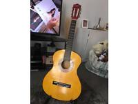Martin Smith 3/4 guitar with tuner.