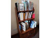 Ercol bookcase and cupboard.
