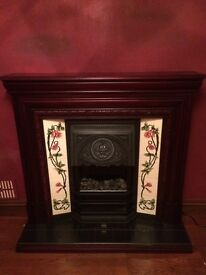 Fireplace surround with electric fire and hearth