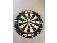 Bristle dart board used once