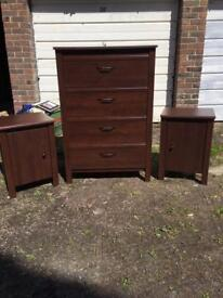 Dark wood chest of drawers and matching bedside cabinets
