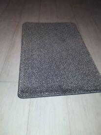 New door mat grey colour size 2 ft 3 ins x 1 ft 6 ins £2