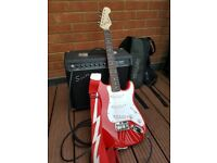 Squier mini Stratocaster 3/4 size child's electric guitar & Squier Champ amplifier + accessories