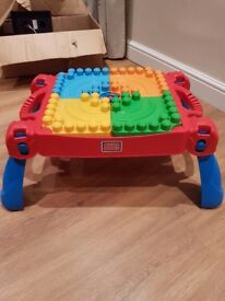 Mega blocks building table. Internal storage. Collapsible for easy storage and transportation.