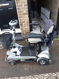 Quingo Flyte Mobility Scooter with loading ramp and remote control for loading and unloading.