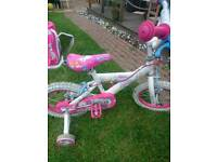 Girls starter bike with stablezers hardly been used suit 3 ish to 5 ish