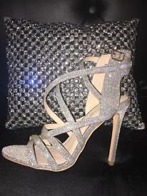 Size 4 silver glitter heels