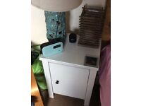 White wooden bedside table
