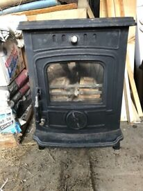 Multi fuel stove and external chimney flue