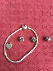 Genuine pandora heart clasp bracelet with three genuine charms and one non genuine