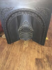 Cast iron period fireplace insert with wooden surround