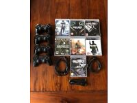 PS3 Wireless Controller, charging cable and games