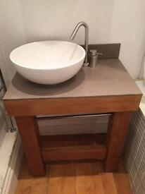 Small table with wash basin and water tap