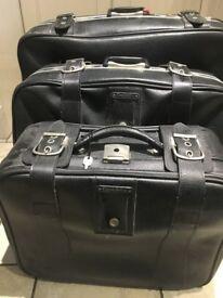 3 black suitcases