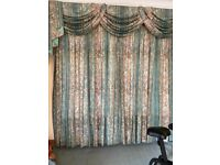 Print chintz curtains with swags and tails pelmet