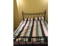 King size black metal bed