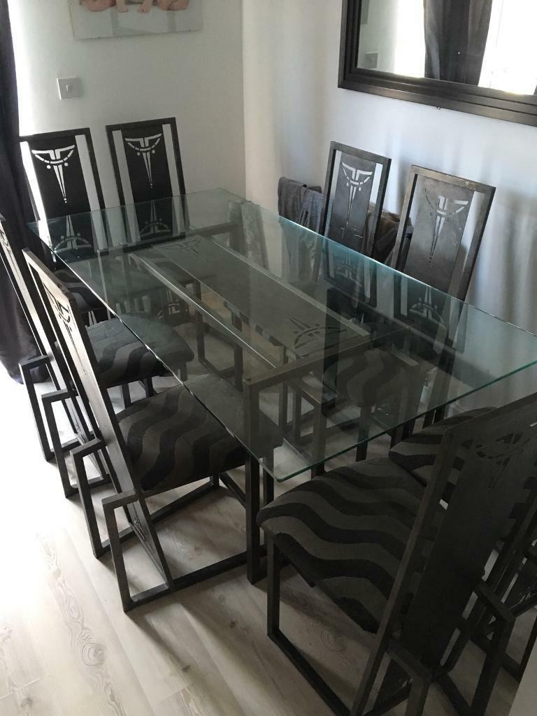 Glass table and 6 chairs