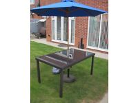Rattan effect tinted glass table L150cm x W90cm x H75cm with Blue parasol and base with cover ex con