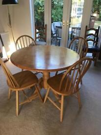 Solid pine round kitchen table and 4 chairs
