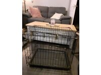 Small black metal dog cage & dog mat