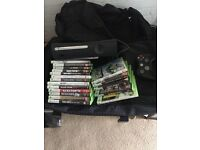 120GB Black Xbox 360 plus 1 controller, 19 games, guitar, and wifi adapter plus power, etc.