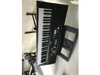 Yamaha electronic keyboard with stand