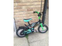 Green and black children's 12inch bike. Good condition